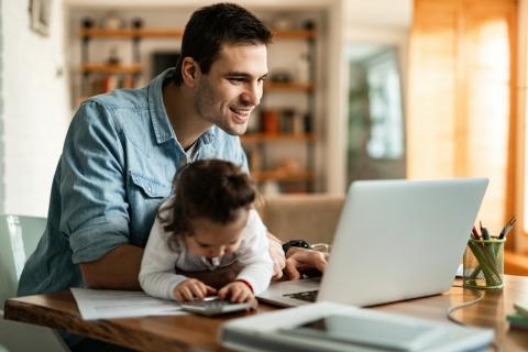 IT-Pro Support | IT Support Denbighshire | man with child on laptop